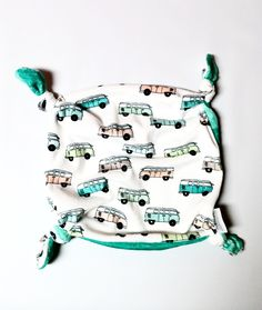 """This double sided minky security blanket is an essential for babies. Its knotted corners give baby something to grab and pull on, and the soft minky fabric on both sides makes it the perfect snuggle blanket. Measures approximately 12""""x12""""."""