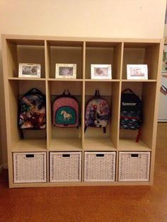 """We've just created this bag and shoe storage unit from an ikea """"kallax """". My husband braced the unit with a length of wood that we put the bag hooks on. Without adding a brace it wouldn't be stable enough (I don't think). ~ Nicole"""