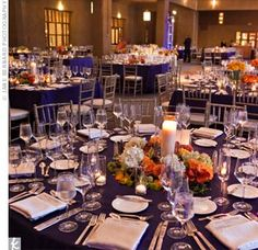 Small orange, white and blue flowers popped against the navy blue table linens. Description from pinterest.com. I searched for this on bing.com/images