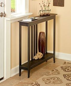 """This Slim Space-Saving Accent Table makes organization a breeze. Its narrow construction fits perfectly in a hallway, small room or behind the sofa. Two sawtooth hangers provide extra stability against a wall. 36""""W x 7""""D x 32""""H. MDF. Assembly required; a"""