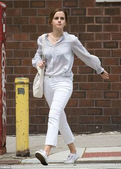 Low-key: Emma Watson, 27, took a break from her busy schedule of late to take a stroll in New York with her friends on Monday