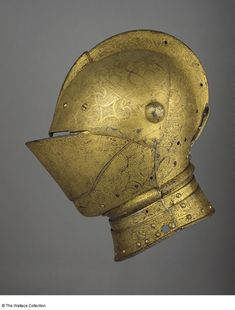 Close-helmet  Attributed to Conrad Richter, Armourer  Augsburg, Germany  1555  Medium-carbon steel, copper alloy, leather, wax, gold, silk and velvet, etched and gilt  Weight: 5.62 kg  Height: 33 cm  Width: 17 cm  A188  European Armoury II Helmet Armor, Knights Helmet, Suit Of Armor, Arm Armor, Medieval Helmets, Medieval Armor, Sea Peoples, Gold Armor, Armadura Medieval