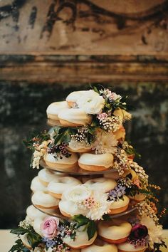 CASEY + ALEX // #wedding #donuts #cake #dessert #reception #elegant #urban #brisbane #flowers #caketopper - tiered wedding cake made of glazed white donuts decorated with flowers for a funky ceremony