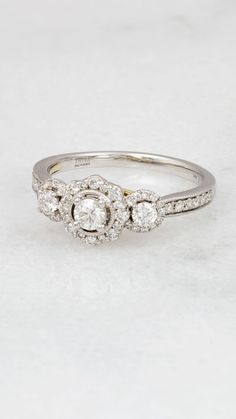Three-stone engagement rings are popular for symbolizing the past, present, and future of your relationship. Oh, and that TRULY™ Zac Posen ✨ helps, too!  #helzberg #ring #diamonds #engagement