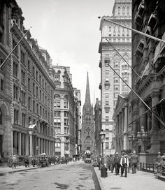 "Lower Manhattan circa 1903. ""Wall Street and Trinity Church, New York."""