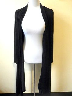 CONDITION: barely used made of black jersey like fabric  MEASUREMENTS: Size: small shoulder 16 sleeves 22 inches bus up to 40 inches (open front) waist up to 46 inches (open front) height 24-48 inches (high low hem; calf high or midi)
