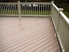@Marcin S brownstone vinyl #deck flooring, Kona border, and @Jen Kempkes tan PVC railing
