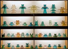 "Matt Weldon's collection of glass pintype power insulators in a display cabinet. According to Matt, ""[t]hese insulators were used for high voltage distribution and are the largest and heaviest glass pintype insulators made in North America.""  For more information, see monon738's flickr stream."