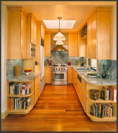 U-Shaped Kitchen  Not nuts about finishes/lighting, but like the layout. would switch stove with sink if window was there.