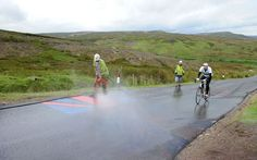 Workmen clean a Union flag off the road near Reeth on Stage one as preparations for the Tour de France continue