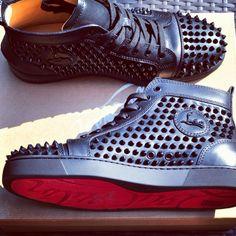 I love these kicks. Christian Louboutin red bottom sneakers