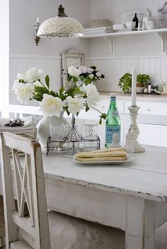 Swedish dining room with gray walls paint color with white beadboard backsplash, tin pendants, white washed dining table, vintage chairs and vintage grain sack, cushions
