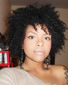 I think more black women should wear their hair natural. It's beautiful... And she's beautiful.