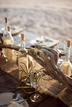 beach inspired tablescape- love the message in a bottles!