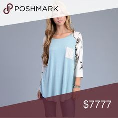 ➡️ COMING SOON!! Baby Blue Boat Neck Top Baby Blue Boat Neck Top with Front Pocket and Floral Background on Back!!! Measurements coming soon!!! Tops