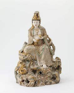 Seated Kannon and dragon | second half 19th century | Edo period or Meiji era | Stoneware with enamels over clear, colorless glaze | Japan | Gift of Charles Lang Freer | Freer Gallery of Art | F1901.16