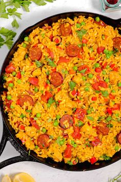 This chicken and chorizo paella is made in a cast iron skillet to get that delicious crispy rice on the bottom. Filled with vegetables and aromatics, this one skillet paella is perfect for feeding the family. #paella #skilletpaella #castironpaella #chickenpaella #chorizopaella #chicken #chorizo Healthy Sausage Recipes, Chorizo Recipes, Rice Recipes, Chicken Recipes, Cooking Recipes, Recipe Chicken, Chicken And Chorizo Paella Recipe, Chicken Paella, Dinner Entrees