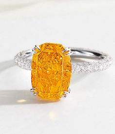 A rare and exquisite 4.19 carat fancy vivid orange diamond ring. In a white gold with brilliant-cut diamonds. Via Diamonds in the Library.