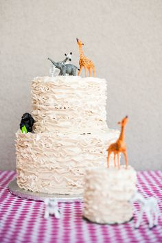 A simple ruffled cake was topped with a menagerie of safari animals to tie in with a safari-themed party. Source: A Little Savvy Event