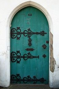 turquoise door, love the bold color and the intricate black iron details.