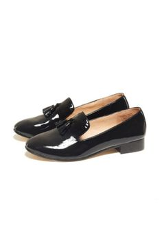 Loafer in Black Patent.   Classic leather loafer with tassel at front, soft pig skin inner and small raised heel.   100% Leather