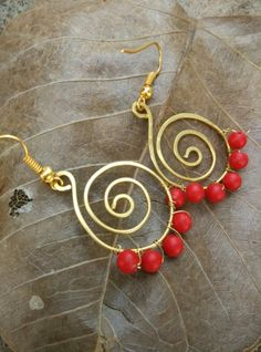 Brass coils with bright red beads along the bottom #wire #jewelry #red #valentine