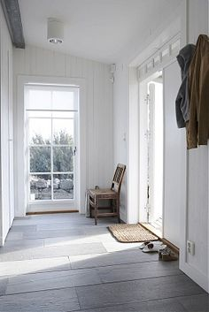 Example of slate floors with white everything.  (I do like the look of that woven door mat with the floors and walls)