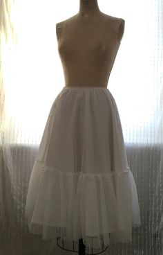 By Hand London DIY sewing tutorial showing you how to make a tulle and cotton petticoat with a gathered ruffle, using our circle skirt calculator.