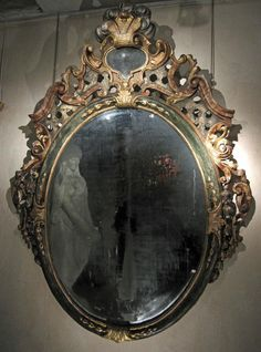 Large oval mirror in #gilt and #silver wood, and #painted with different #marbles. Vintage decor. Sicily, #Italy. Early #18th century. For sale on Proantic by Galerie Marc Philippe.