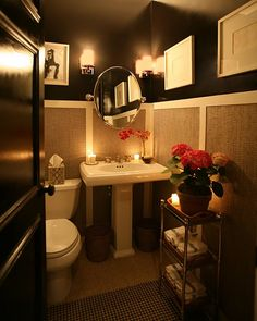 imagining a version of this: maybe grasscloth panels + black patent walls.  just not sure about a jute rug in the bathroom