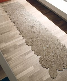Crochet rug by Paola Lenti.  Wonderful, but I think it would look much better as a table runner, not a rug.