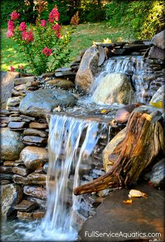 Two-tier waterfall cascade designed and installed by Full Service Aquatics of Summit, NJ 07901