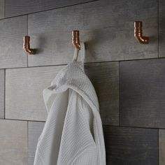 Copper piping makes great hooks and is really on-trend. The perfect place to hang your fluffy bathrobe.
