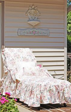 Outdoor slipcovers. How comfy would this be. Need to make something like this for my patio lounger, maybe in a blue and green plaid fabric for the base pillows and a green ditzy floral print for the ruffles.