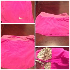 """Nike Dri-Fit Workout SKORT Nike Dri-Fit Workout SKORT. The Size is XS. This SKORT is the color Fuchsia with Gray Nike Swoosh. The Length is """" 11.5.  Laying flat from side to side is """"12.  This item is in Good condition, with a small hole in the front of SKORT. The last photo is zoomed in to show detail of the hole. This SKORT is Authentic and from a Smoke And Pet free home. All Offers through the offer button ONLY. I Will not negotiate Price in the comment section. Thank You Nike Skirts"""