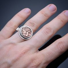 This Sterling silver antique styled ring features a magnificent reproduction coin from the times of Alexander the Great. The Greek demi-god Herakles (Hercules) is portrayed here wearing the skin of the Nemean Lion. Please comment or DM for purchasing inquiries.  #numismatics #herakles #archaeology #archeology #mensjewelry #hercules #alexanderthegreat #oldcoins #antiquejewelry #vintagejewelry #silversmith #uniquejewelry #thegetty #handmadejewellery #handmadejewelry #britishmuseum…
