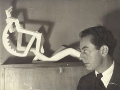 "Man Ray, Autoportrait à la ""Femme angoissée dans une chambre la nuit"" d'Alberto Giacometti, Paris, ca 1932  Giacometti's sculptures were photographed by Man Ray for publication in Cahiers d'Art in 1932. In gratitude Giacometti gave Man Ray a number of his own works, such as the plaster sculpture Femme angoissée dans une chambre la nuit, captured in the present self-portrait.  photo and text from Sotheby's"