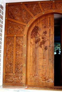 Solid teak door to the 'Teak Museum' near Nilambur, Kerala, India