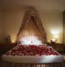 Romantic Rose Petals all over this canopy bed!