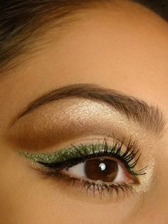 Brown eye shadow with green eyeliner. Petty look made unique with the bold eyeliner ( I don't think I'd be able to extend the eyeliner the same). Great colours that enhance your eyes & makeup. I will try as soon as I buy coloured eyeliner!!