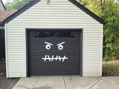 Monster Garage Door-Halloween Decoration  Easy 2 make.  White duck tape, paper plates with black paint, and hair is old table centerpiece taken apart and stapled on ribbon.