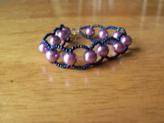 "7.5"" woven bracelet with lavender glass pearls and glass bluish-purple AB seed beads. by StrungOnLove on Etsy"
