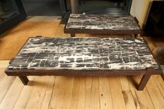 Pair Of Coffee Tables In Petrified Wood And Iron | at www.1stdibs.com
