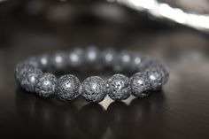 """Black Lavastone (10mm)  (quote)""""Created for my husband's late father 50% of profits from this bracelet will go directly to fight Melanoma Skin Cancer."""""""
