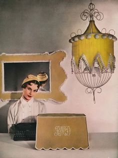 so love the covered birdcage....April Harper's Bazaar 1950 by Louise Dahl Wolfe  Wearing an ivory silk shirt and a curved hat by Sally Victor