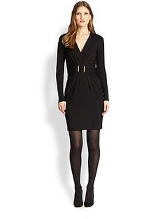 PAULE KA - Belted Wool Jersey Dress - Saks.com, $900.  From what I can tell, the belt is a wide band, twisted once in the back before being sewn together (like a twisted infinity scarf) so it looks less 80s Units.