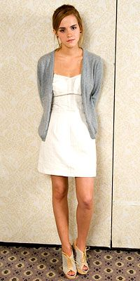 Emma Watson, luv the dress and sweater... not crazy about the shoes!!! but the best part about it is the actor!!!!