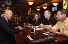 Calgary Elbow MLA Greg Clark, left, speaks to Alberta Party vice-president Mitch Lindsay, right, secretary Robert Tipple and director at large Kelsey Hayes following the annual general meeting of the party at The George in Okotoks on Feb. 8.