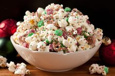 Christmas Crunch    Ingredients:  1/2 cup popping popcorn kernels, or 2 bags tender white popcorn  1 (12 oz) bag Vanilla Candy Melts (such as Wilton Candy Melts)  1 1/3 cups broken pretzel pieces  1 (12 oz) bag green and red Milk Chocolate or Mint M  Red, green and white Sprinkles (I used Jingle Mix Nonpareils)