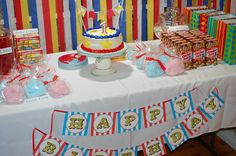 Birthday decor for a lucky boy who likes to clown around! Draped red, yellow, blue and white streamers in front of built in bookcase, table filled with cake, popcorn, cotton candy, animal crackers,Twizzlers, salt water taffy with tent striped gift bags to fill and you have a memorable take home gift! ....and don't forget an adorable banner♥ available at etsy and many other craft sites.